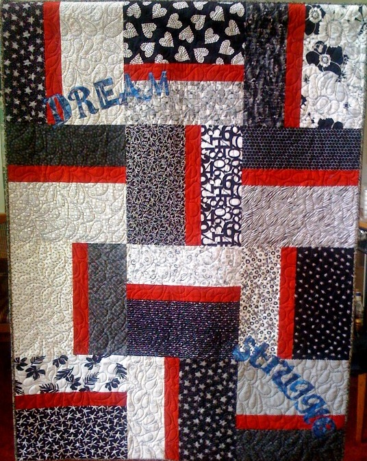 Subtle Struggle Toward the Dream, 45 x 60 inches, by O.V. Brantley, 2011. For sale at www.etsy.com/shop/ovbrantleyquilts