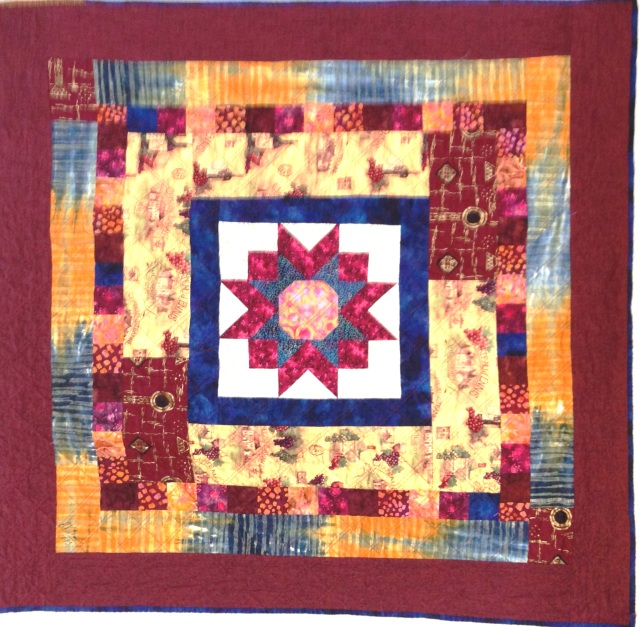Vineyard Star at Sunset, 42 x 42 inch quilt by O.V. Brantley, 2013.