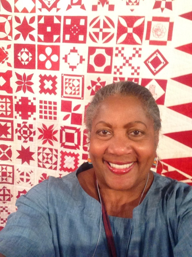 O.V. Brantley with a red and white sampler quilt, Houston, TX