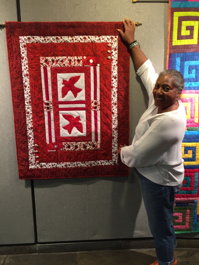 "O.V. Brantley with ""Disagreement"", 36x48 inch art quilt by O.V. Brantley, 2016. For sale at ovbrantleyquilts.com"